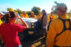 Team from The Nature Conservancy receive instructions prior to a test burn